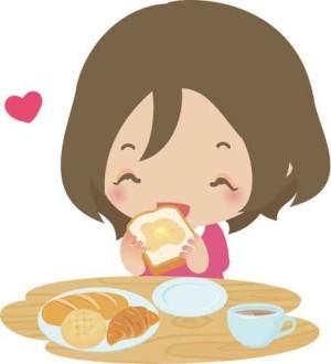 パンを食べる笑顔の女性
